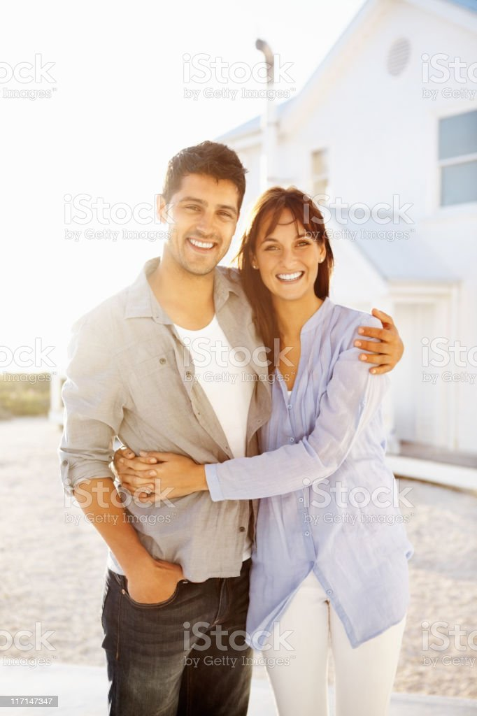 Young couple embracing outdoors royalty-free stock photo