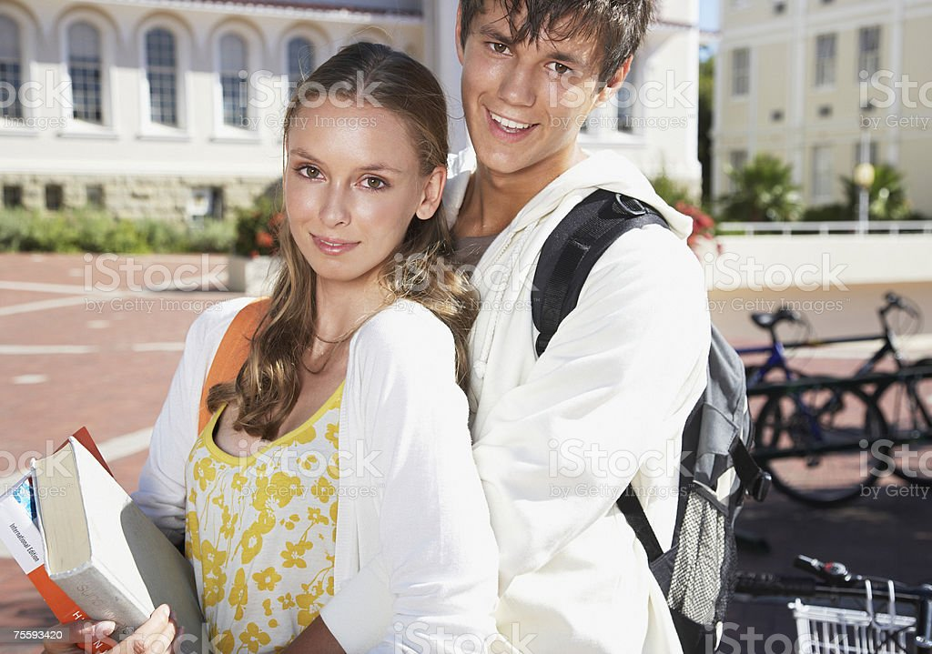 A young couple embracing outdoors royalty-free stock photo