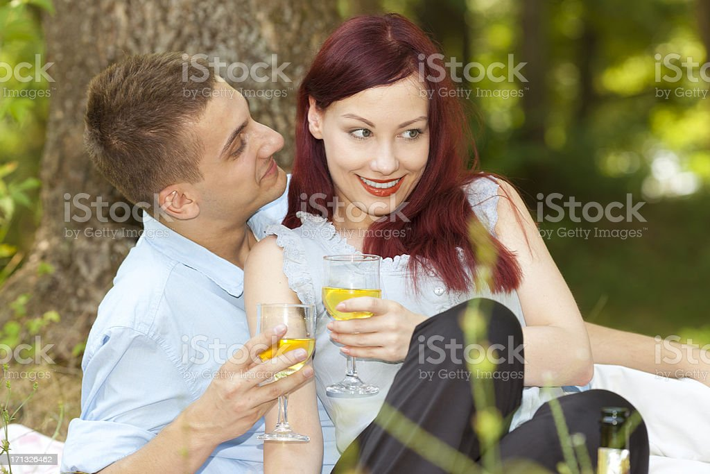 Young couple enjoying a glass of wine outdoors royalty-free stock photo