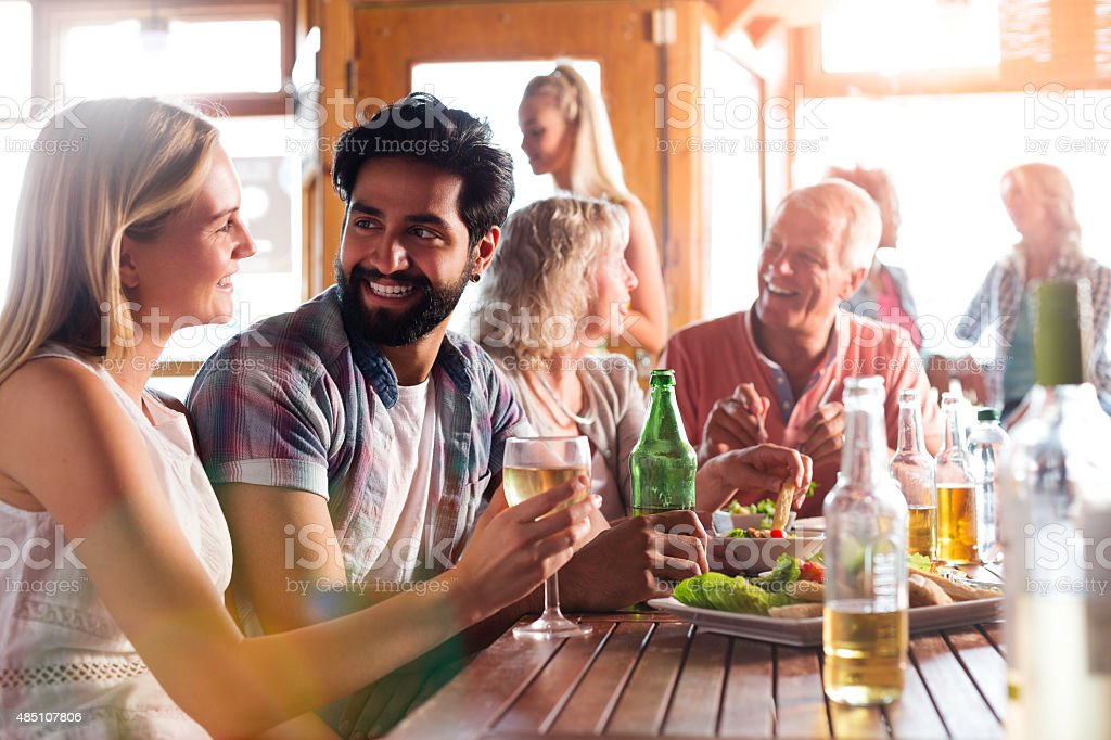 Yound Couple Enjoying a Meal and a Drink stock photo