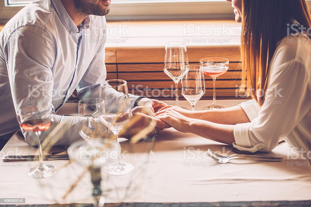 Young Couple Enjoying a Romantic Dinner stock photo