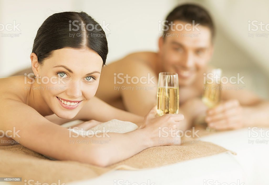 Young couple enjoying a spa session and a glass of champagne stock photo