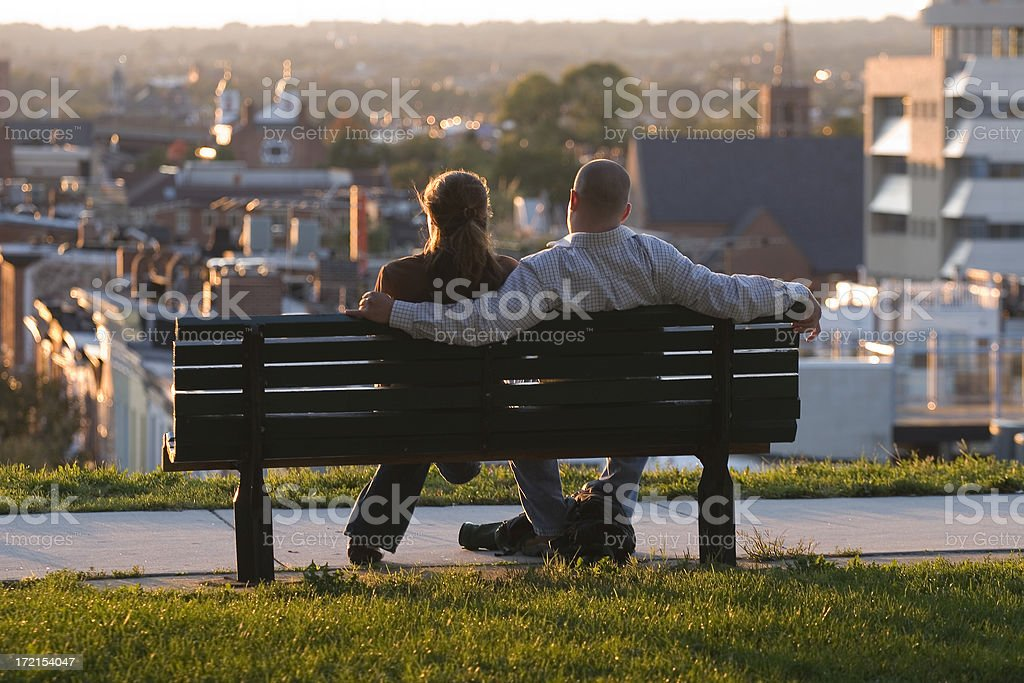Young Couple Enjoying a Sunset royalty-free stock photo