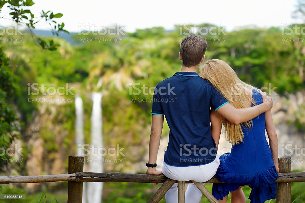Young couple enjoying a view on Chamarel falls stock photo