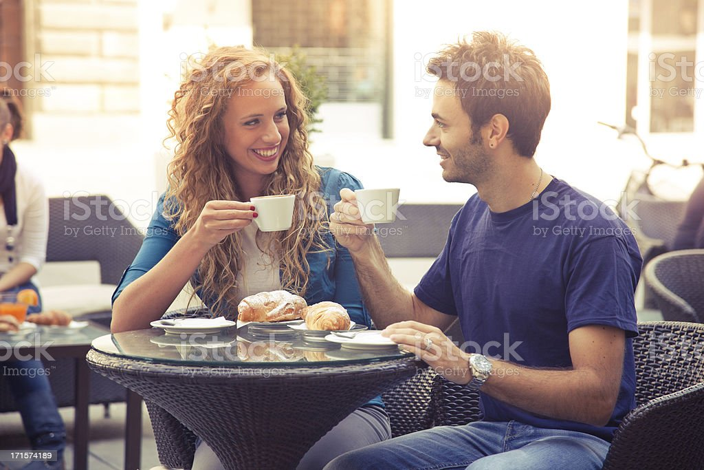 Young couple enjoying breakfast in cafe stock photo
