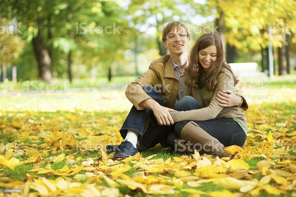 Young couple enjoying bright and warm autumn day royalty-free stock photo
