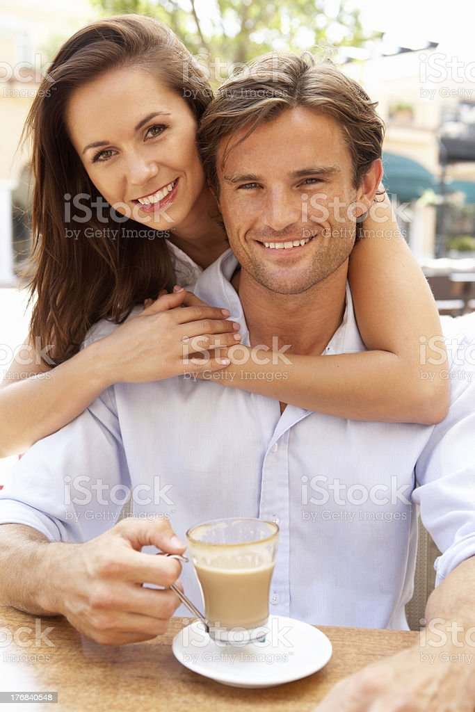 Young Couple Enjoying Coffee In Caf royalty-free stock photo