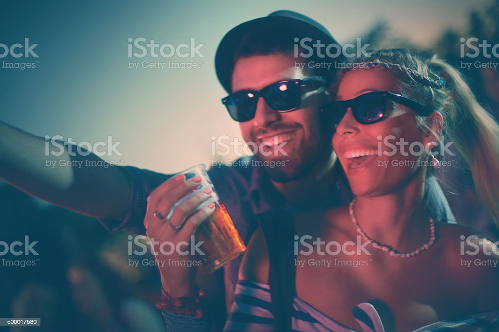 Young couple enjoying concert party. stock photo