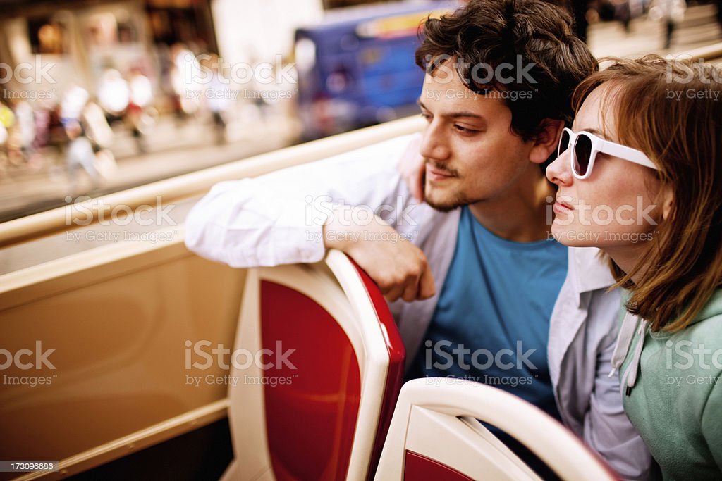 Young Couple Enjoying Double-Decker Bus ride in London royalty-free stock photo