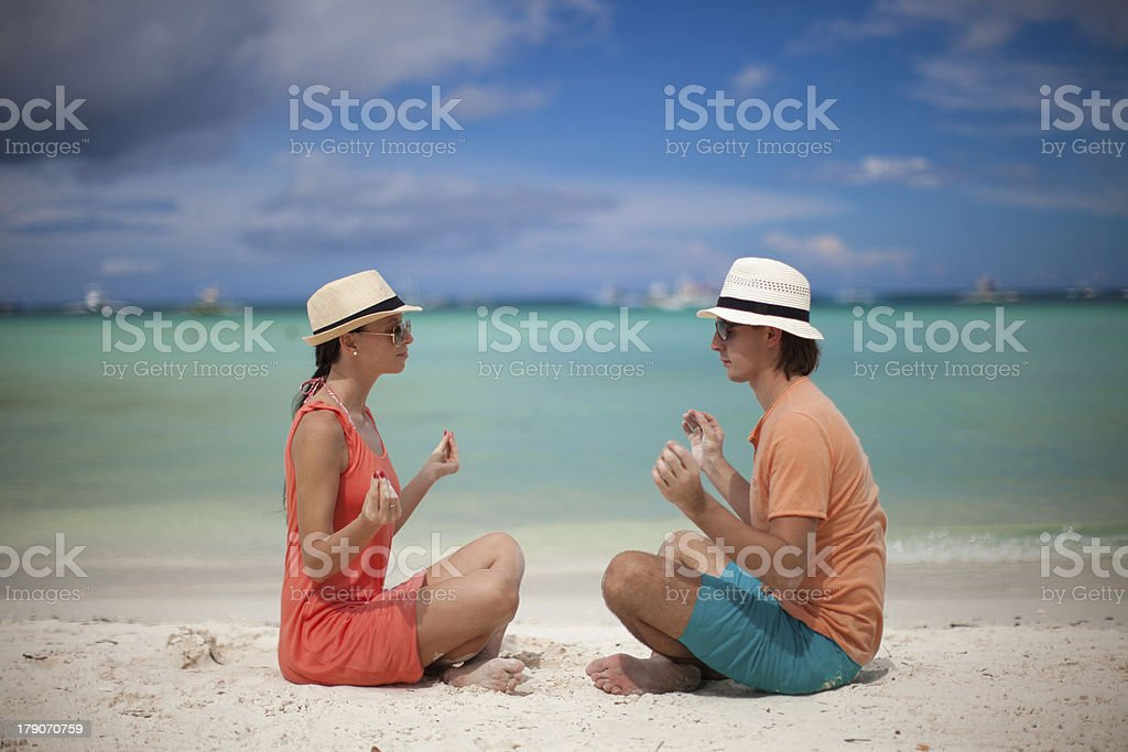 Young couple enjoying each other and yoga on a beach royalty-free stock photo