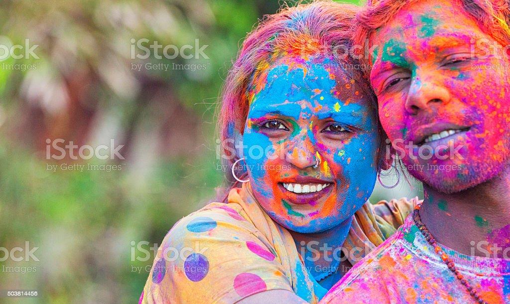 Young Couple Enjoying Holi Festival stock photo