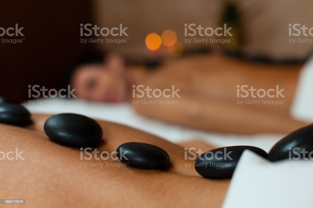 Young couple enjoying lastone therapy stock photo