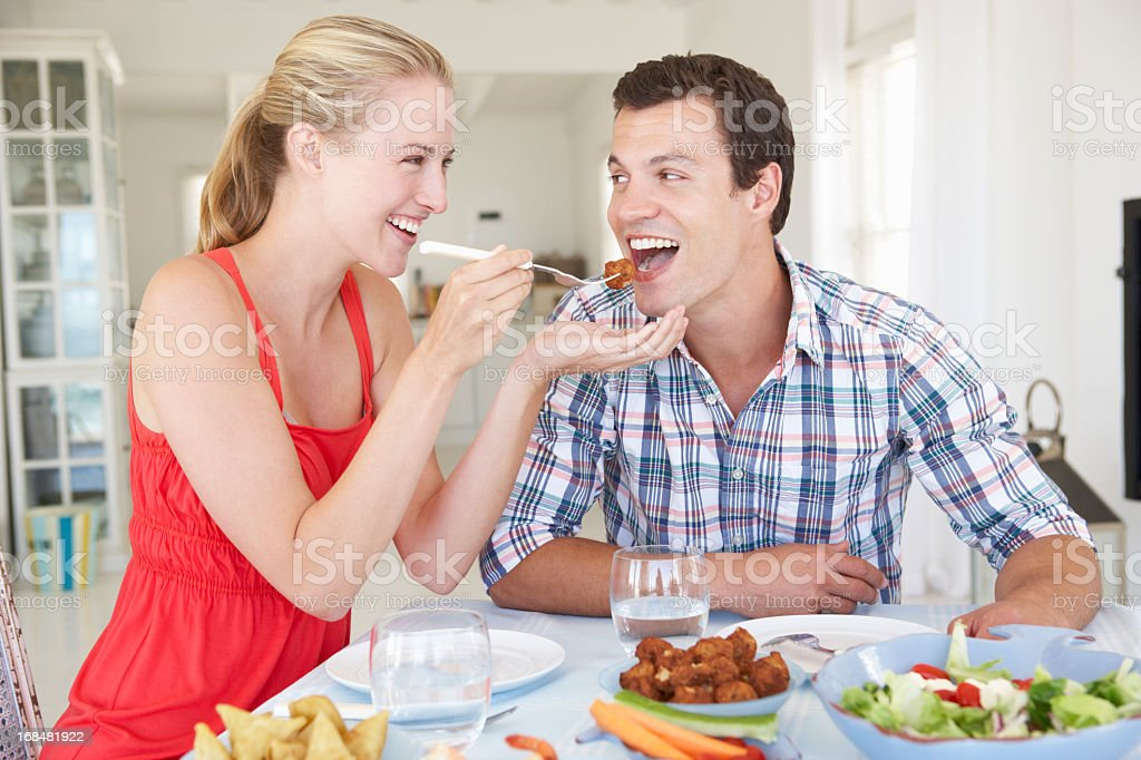 Young Couple Enjoying Meal At Home royalty-free stock photo