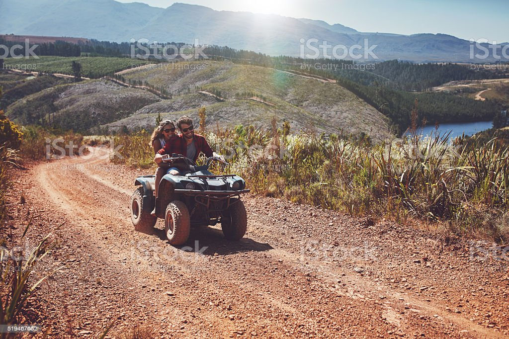 Young couple enjoying off road vehicle ride stock photo