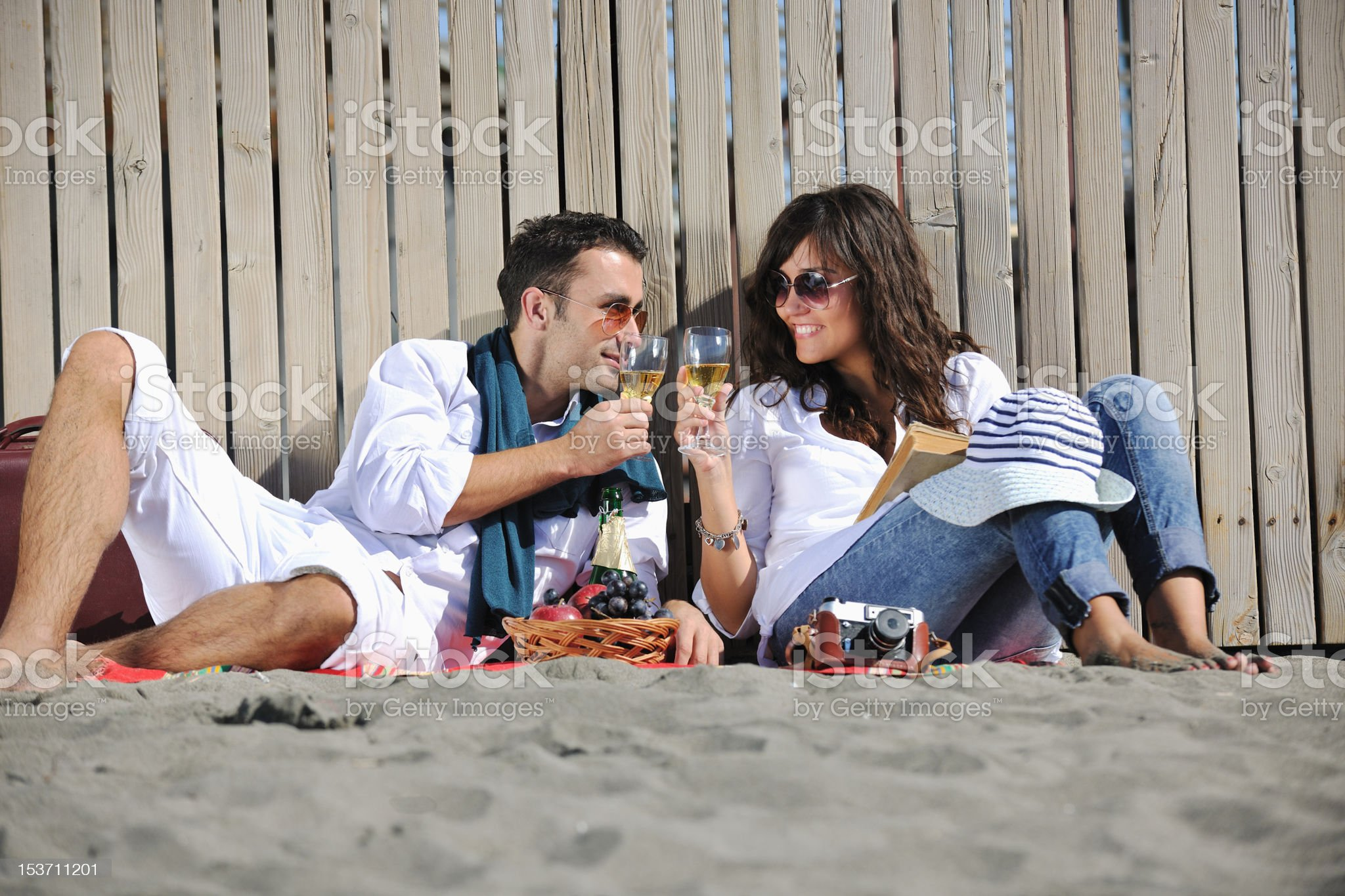young couple enjoying  picnic on the beach royalty-free stock photo