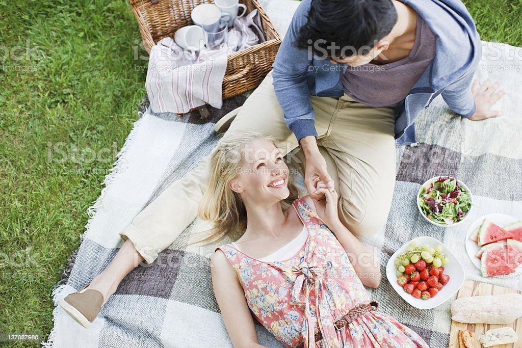 Young couple enjoying picnic stock photo