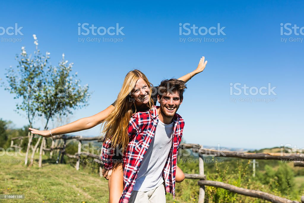 Young couple enjoying pleasant weather in outdoor stock photo