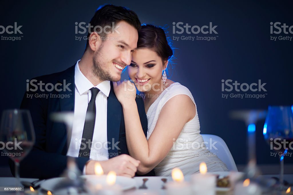 Young couple enjoying romantic meal together stock photo