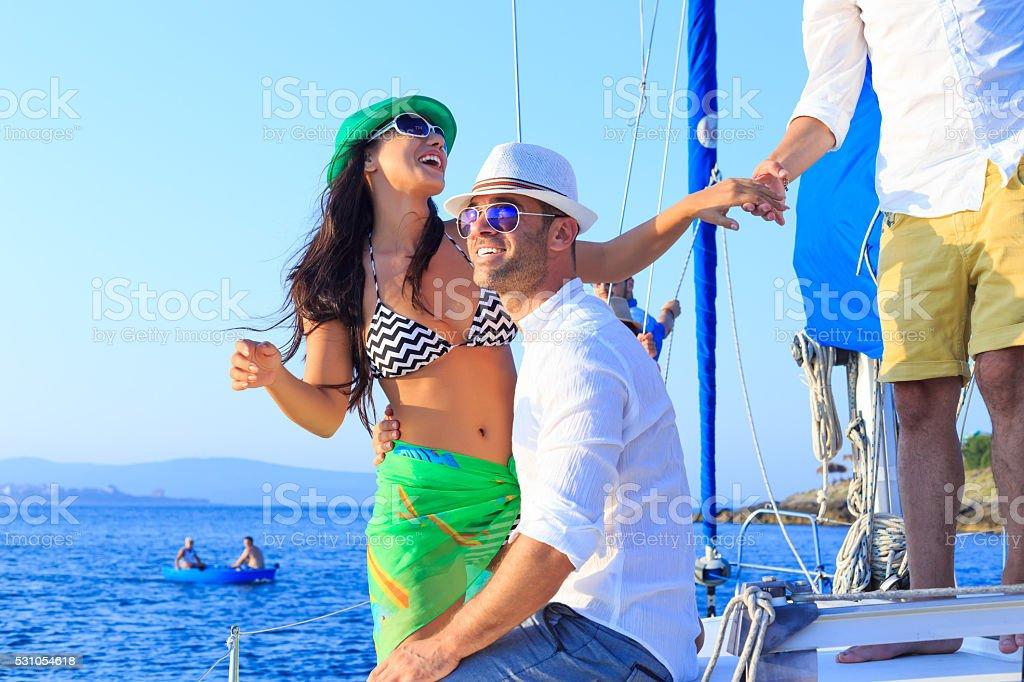 Young couple enjoying sailboat trip stock photo