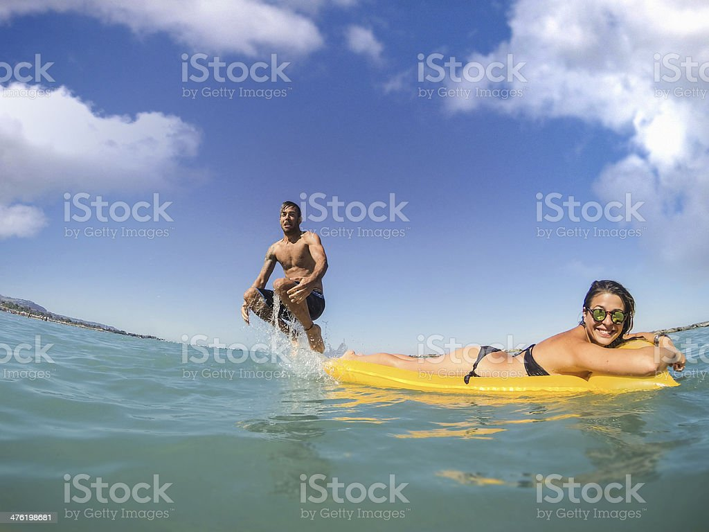 Young couple enjoying summer on the beach royalty-free stock photo