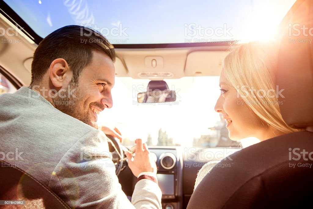 Young couple enjoying the drive stock photo