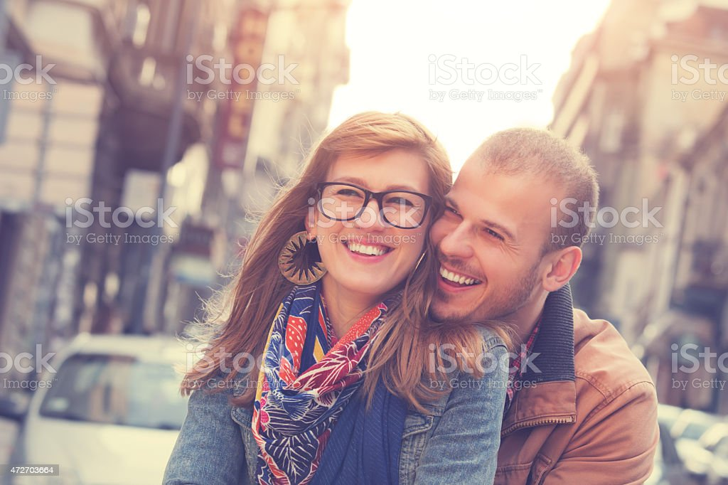 Young couple enjoying the outdoors in a urban surroundings stock photo