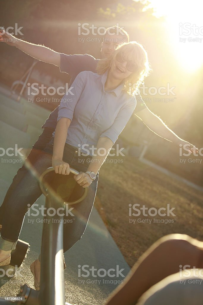 Young couple enjoying the seesaw royalty-free stock photo