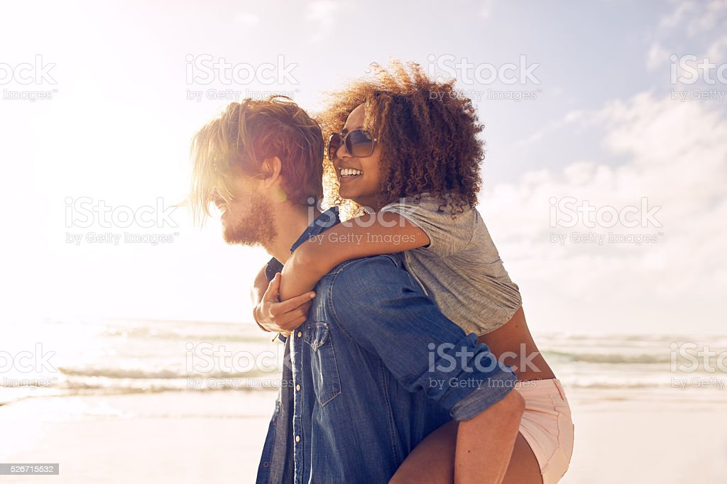 Young couple enjoying their summer vacation on beach stock photo