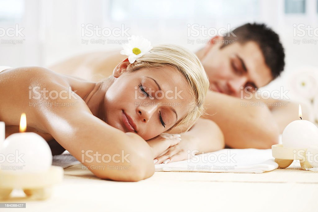 Young couple enjoying themselves at the spa centre royalty-free stock photo