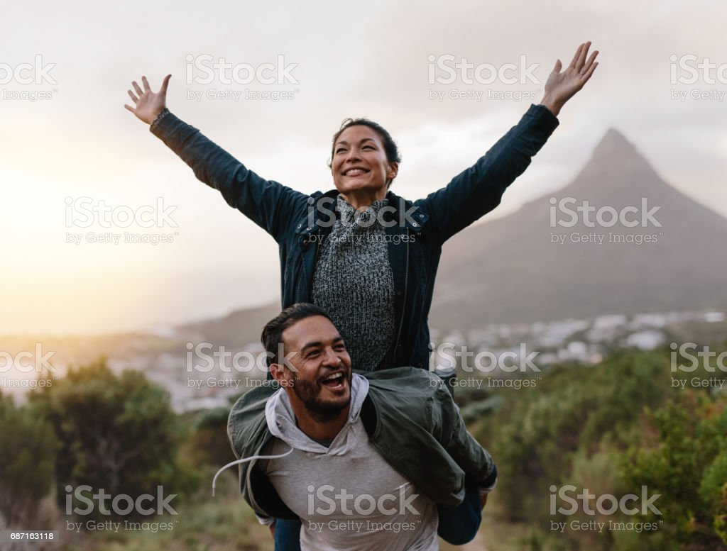 Young couple enjoying themselves in countryside stock photo