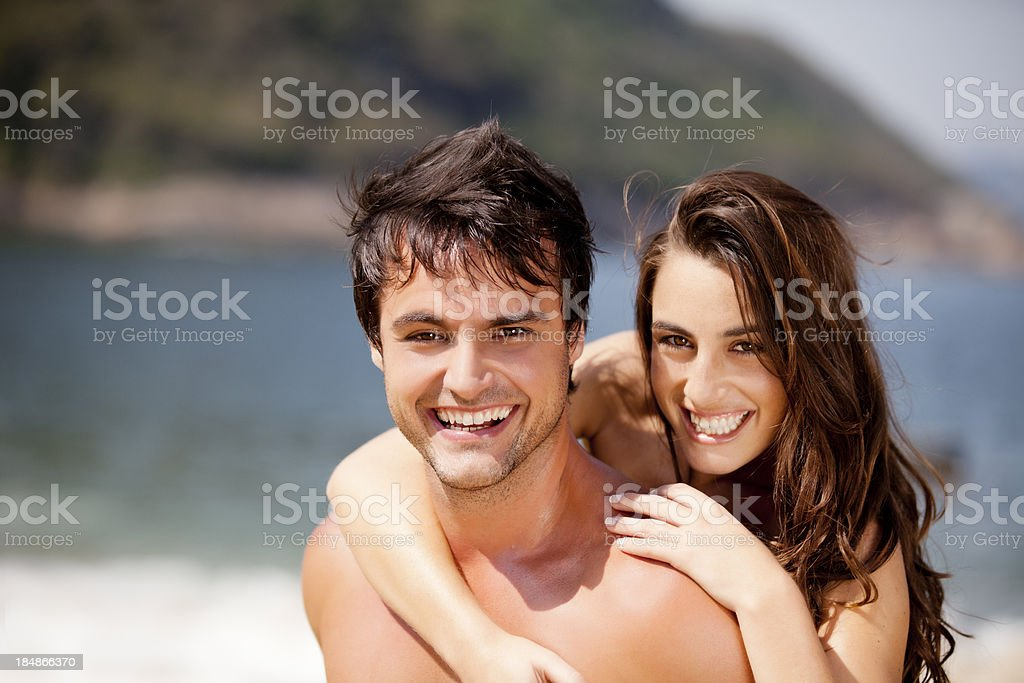 Young couple enjoying time on the beach royalty-free stock photo