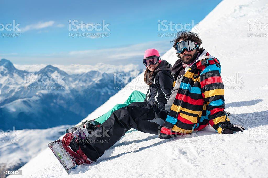 young couple enjoying winter mountains stock photo