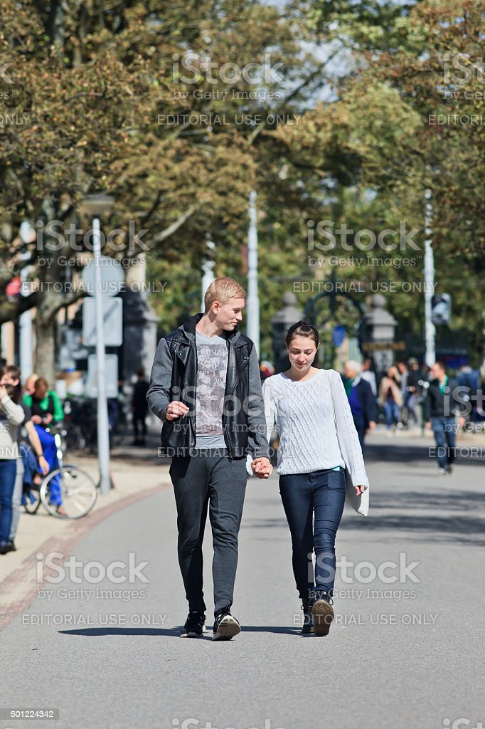 Young couple enjoys a walk in the Vondelpark, Amsterdam stock photo