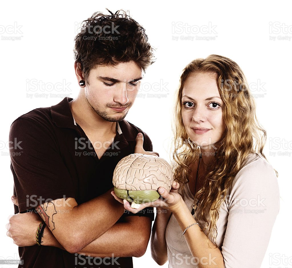 Young couple examine model brain, fascinated royalty-free stock photo