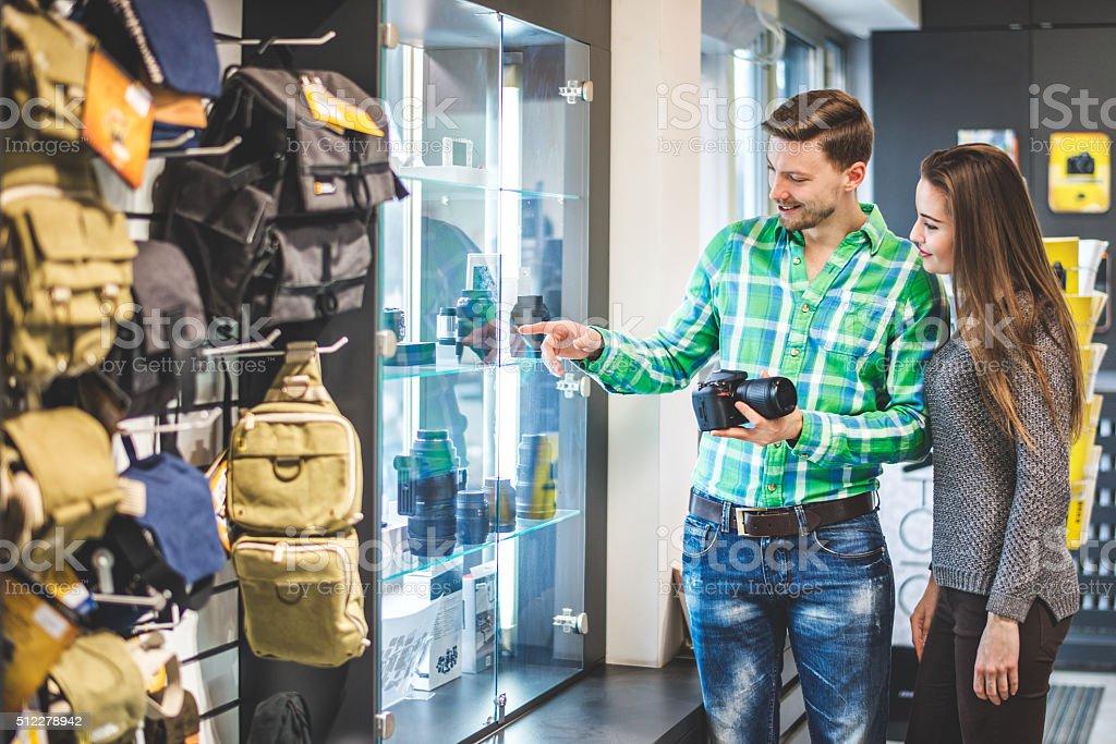 Young couple examining camera lenses stock photo