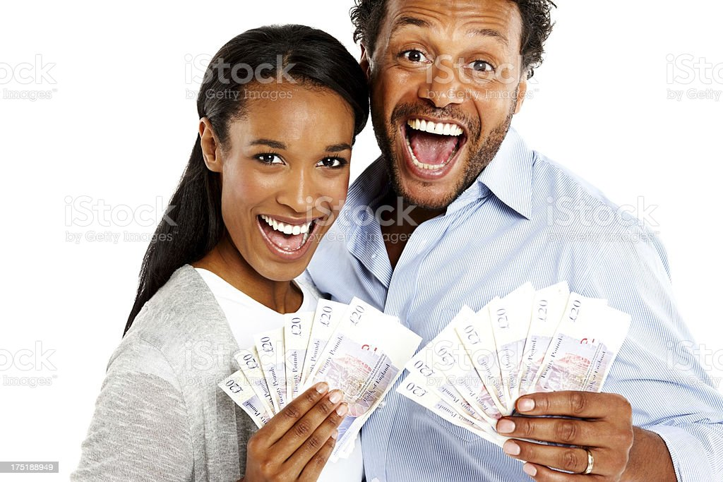 Young couple excited about money against white royalty-free stock photo