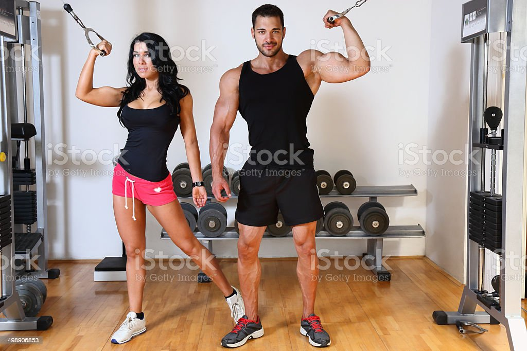 Young couple exercising in gym royalty-free stock photo