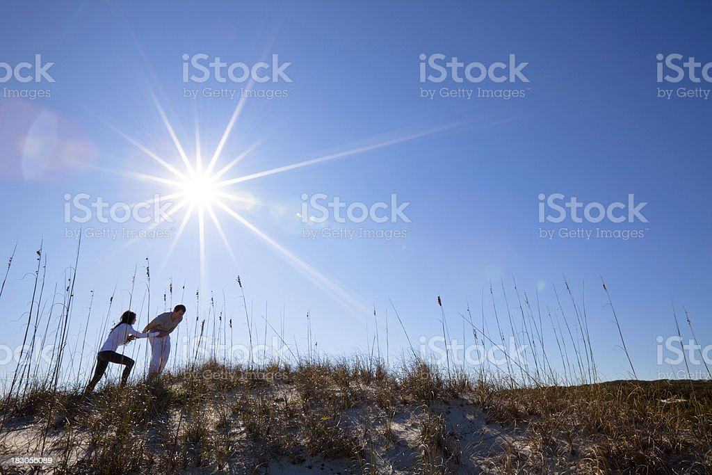 Young couple exploring the dunes royalty-free stock photo