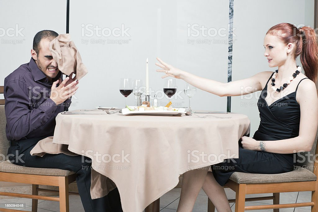 Young couple fighting during a meal stock photo