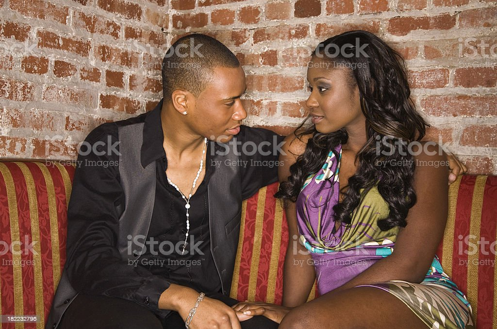 Young couple flirting at a club royalty-free stock photo