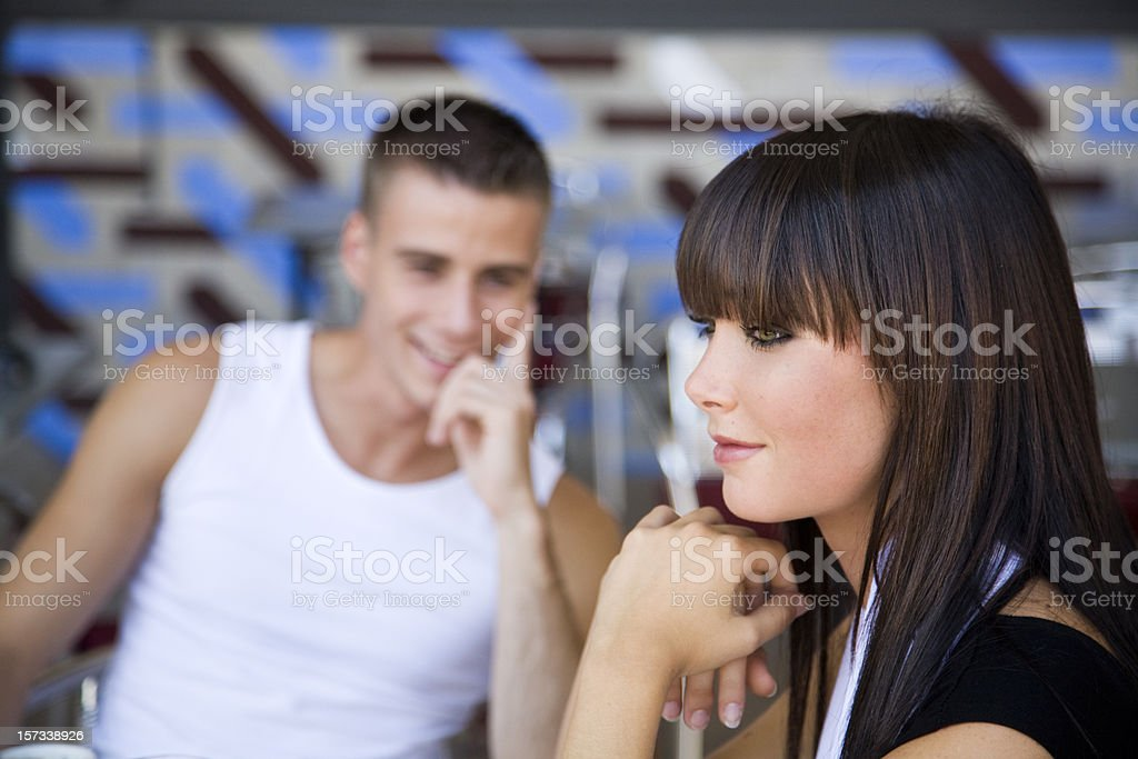Young couple flirting in cafe royalty-free stock photo