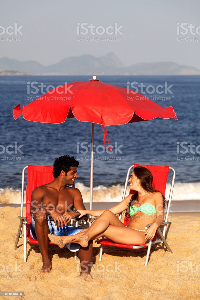 Young couple flirting in the beach royalty-free stock photo