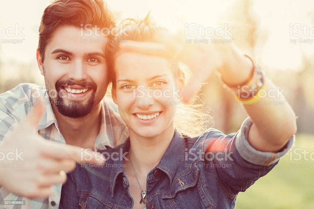 Young couple framing with hands stock photo