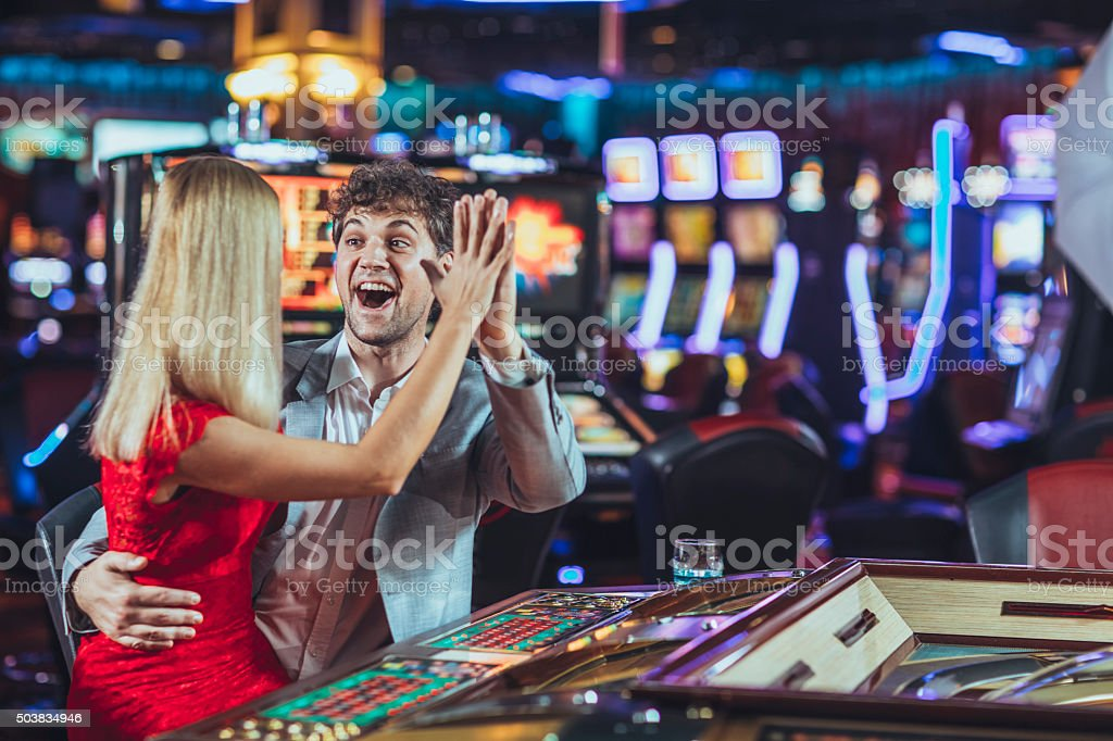 Young couple gambling at the casino stock photo
