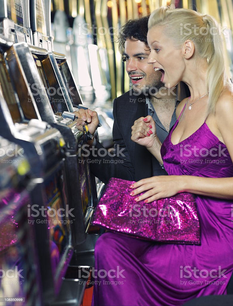 young couple gambling in the casino stock photo