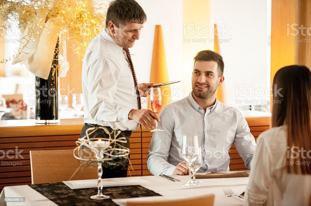 Young Couple getting an Aperitivo at a dining Table stock photo