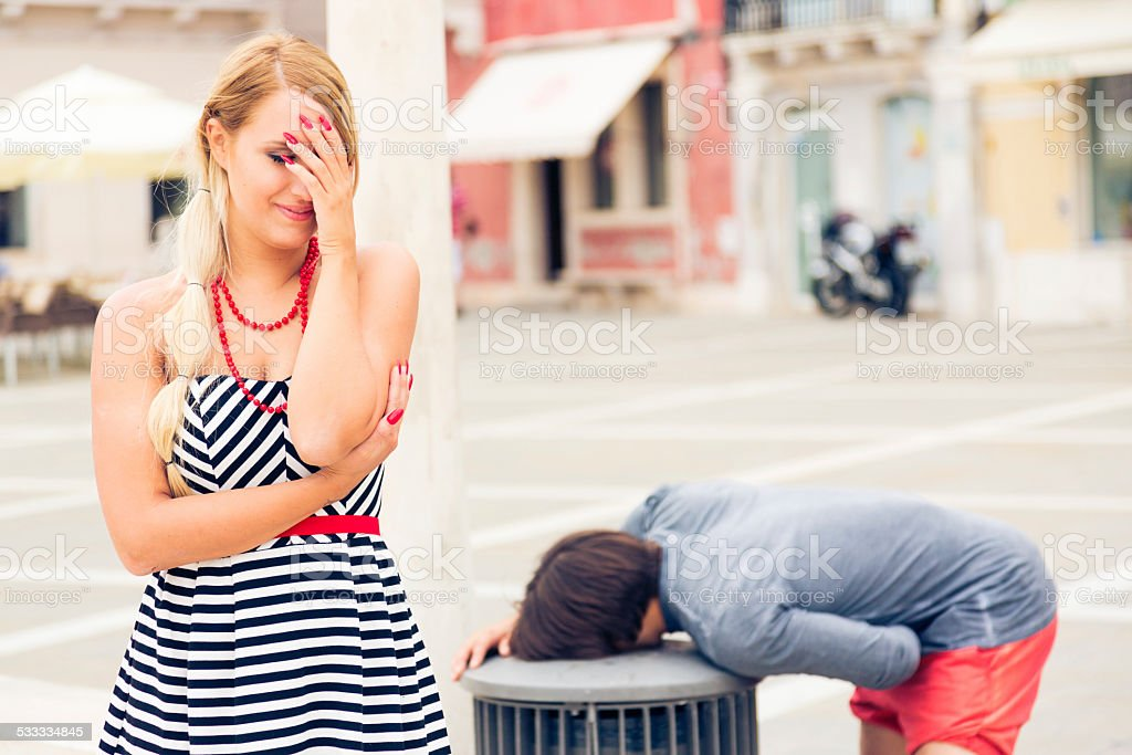 young couple going through an embarassing moment stock photo