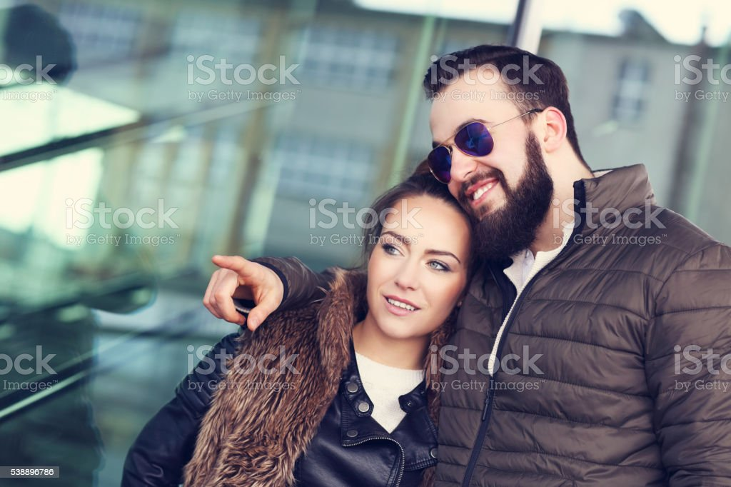 Young couple hanging out and pointing stock photo