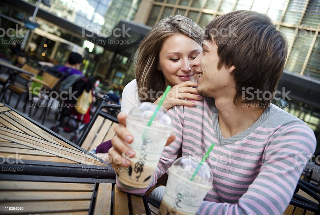 Young couple happy together looking face-to-face stock photo
