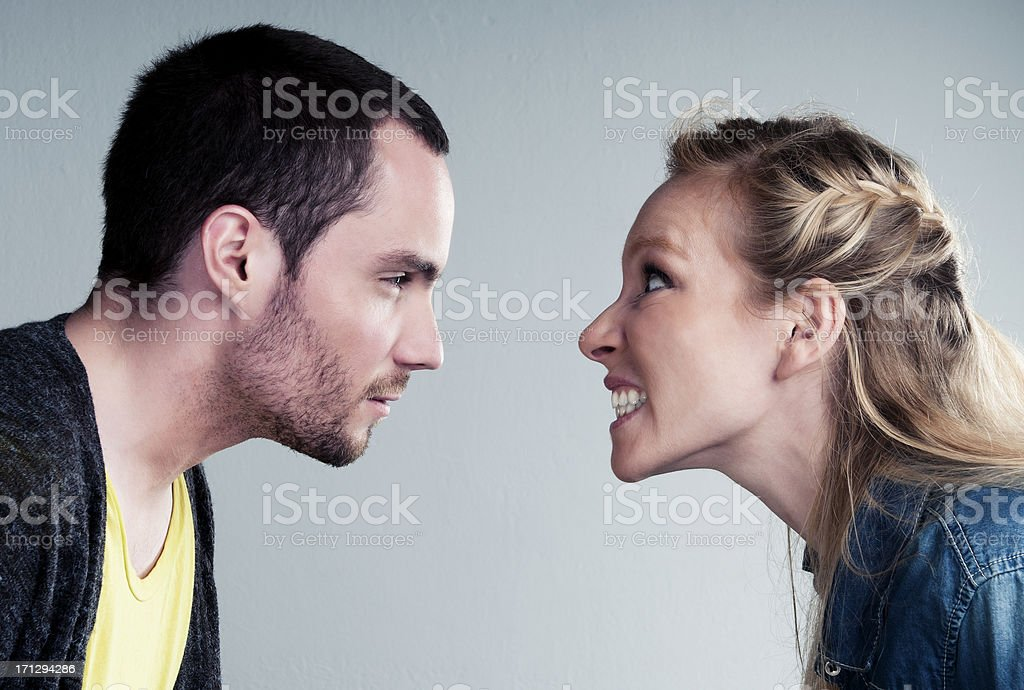 Young couple has a big argument or heated discussion stock photo